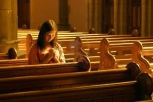 240334-woman-praying-at-church